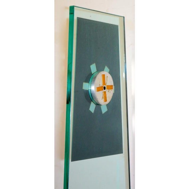 Tall Mid-Century Modern sleek transparent Kienzle floor clock with mirrored face in excellent used condition.