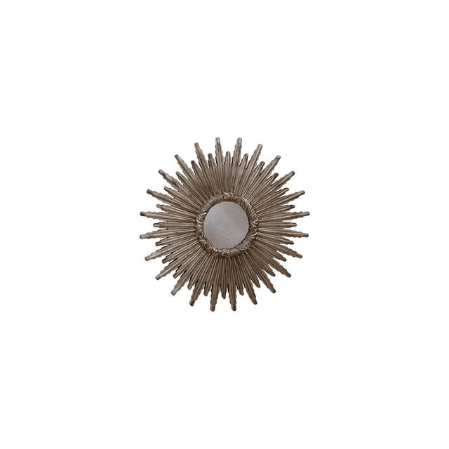 A stunning large silver sunburst mirror, early 21st century. Lightly antiqued mirrored glass. This French Style Sunburst...