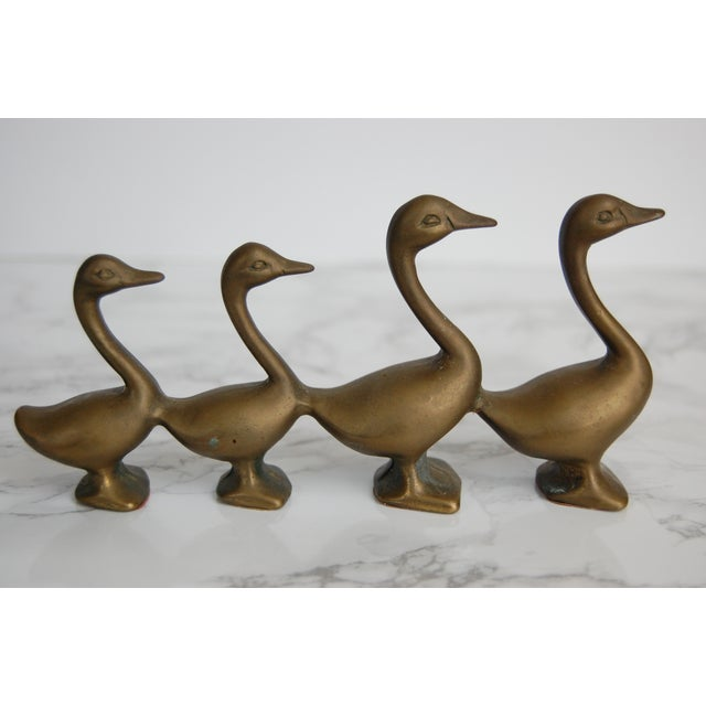 Cute little brass goose/geese family ready to strut across your shelf or table! This little family has four attached brass...