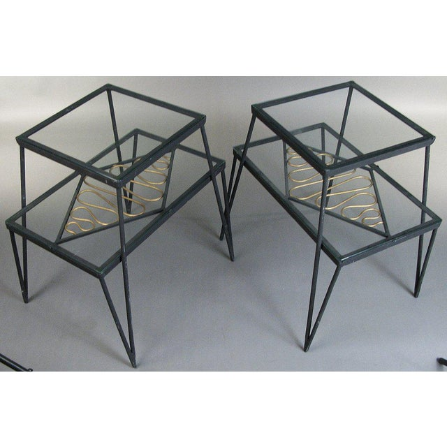 a very unique pair of vintage 1960's tables with bases in wrought iron, 2 glass shelves, and a lovely gilt gold ribbon...
