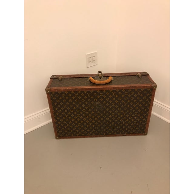 Louis Vuitton 70 size serial number 778676, bought from Jordan Marsh Co. Boston, some scuffs and expected wear, no key....