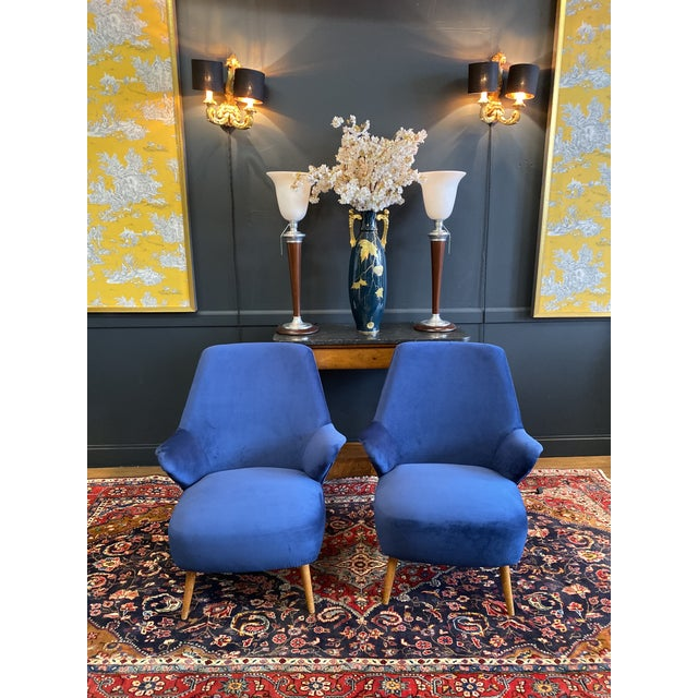 This pair of Mid-Century modern lounge chairs features the unique design style of Gio Ponti. New blue velvet cotton...