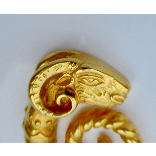 """Gilt Opposing Rams heads - coil earring. Reverse marked Jaded. Size .75"""" by 1.25"""" tall. Vintage Pair of Earrings in..."""