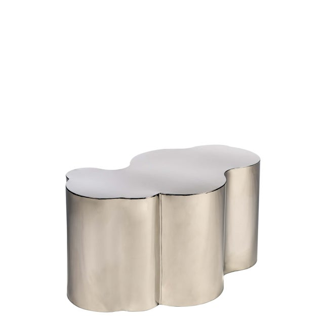 This is a new, modern coffee table with a free form. It is a statement piece that would be a great addition to any home!...