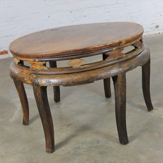 Handsome antique Chinese round and hand carved center table of elm wood. This table is in good antique condition with lots...