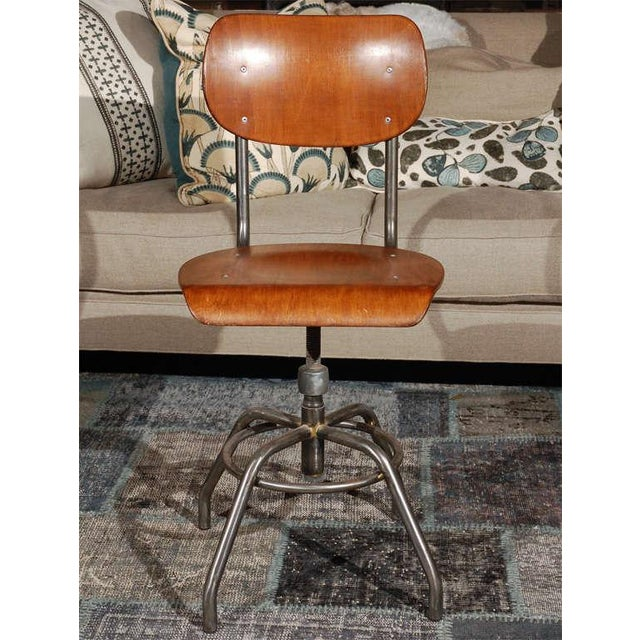 1920 French wood and metal swivel chair. Chair with a curved seat above ringed and spider legged base (five chairs...