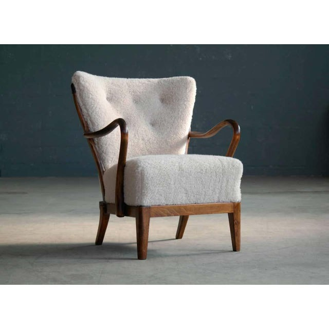 Sculptural and very beautiful 1940s model 117 high back open arm lounge chair made of stained beechwood by Slagelse...