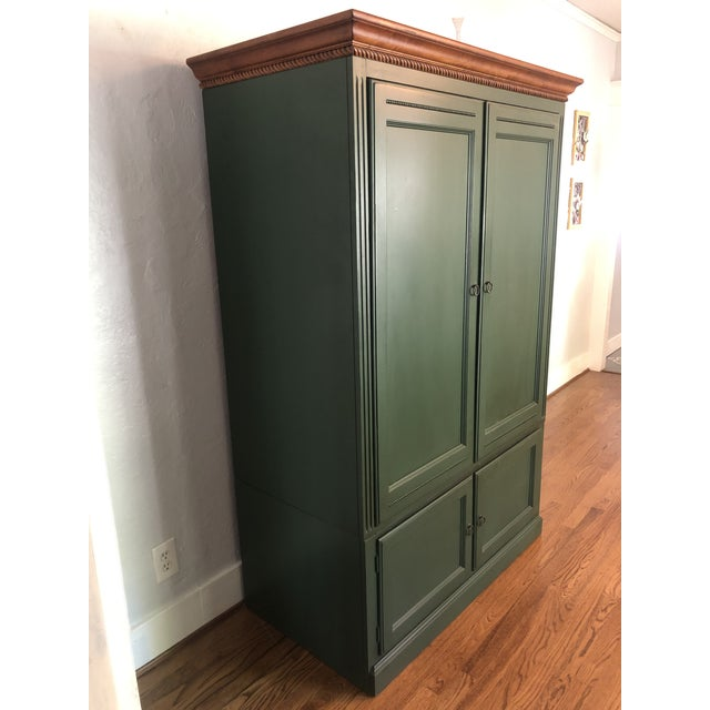 Ethan Allen TV Armoire Country Crossing in a gorgeous hunters green with bifolding doors that slide into the interior....