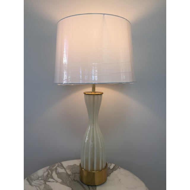 Italian modern glass and brass table lamp. All original parts. In excellent working condition. Very elegant and beautiful.