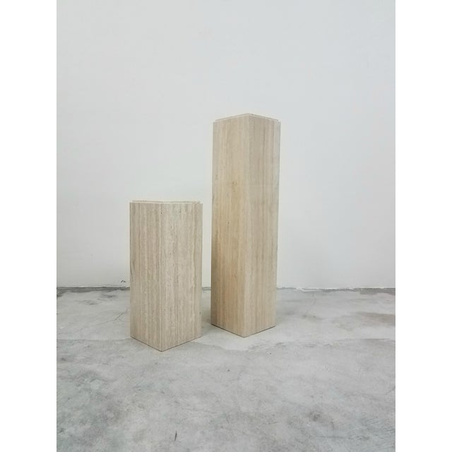A beautiful coordinating pair of square Italian travertine pedestals. Perfect to display your favorite sculpture, bust or...
