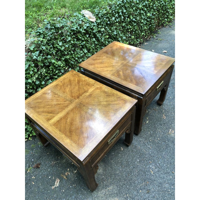 Pair of vintage Thomasville side tables from the mystique collection. Like new condition. Campaign style with an Asian...