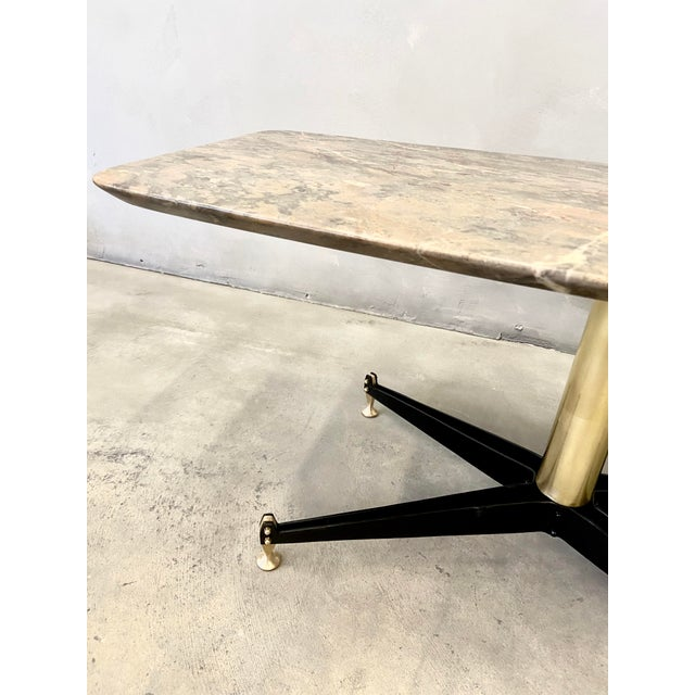 Important table, black steel legs with adjustable polished solid brass feet, original marble on top. Design: Sergio Mazza...