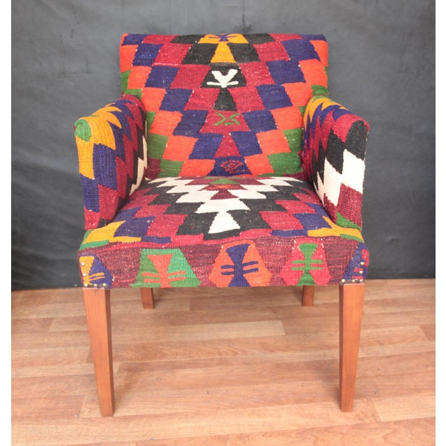 A beautiful one of a kind handmade kilim covered armchair, it is constructed from hornbeam wood. This comfortable armchair...