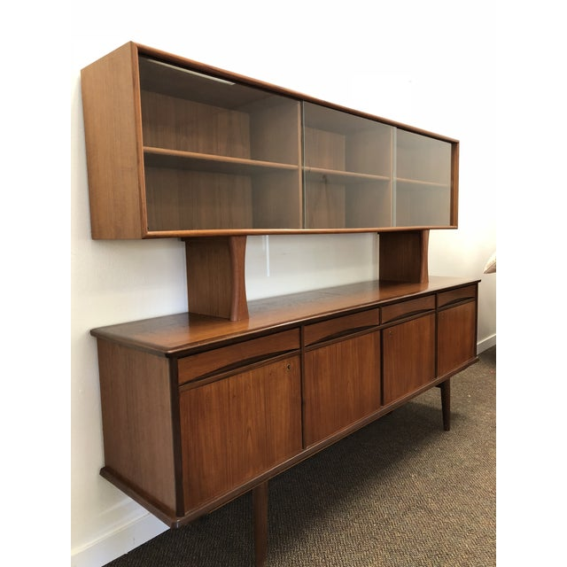 Sought after Danish credenza by HR Hansen's Mobelindusri. Lower cabinets lock. One of the cabinet locks I am unable to...