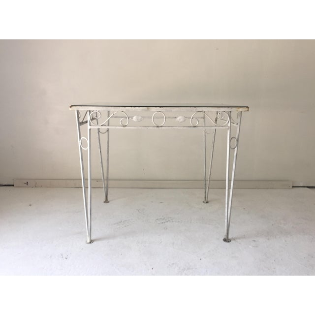 Vintage (c.1970's) Apartment-size wrought iron table with glass top. Will paint to order for add'l $100. We deliver to...