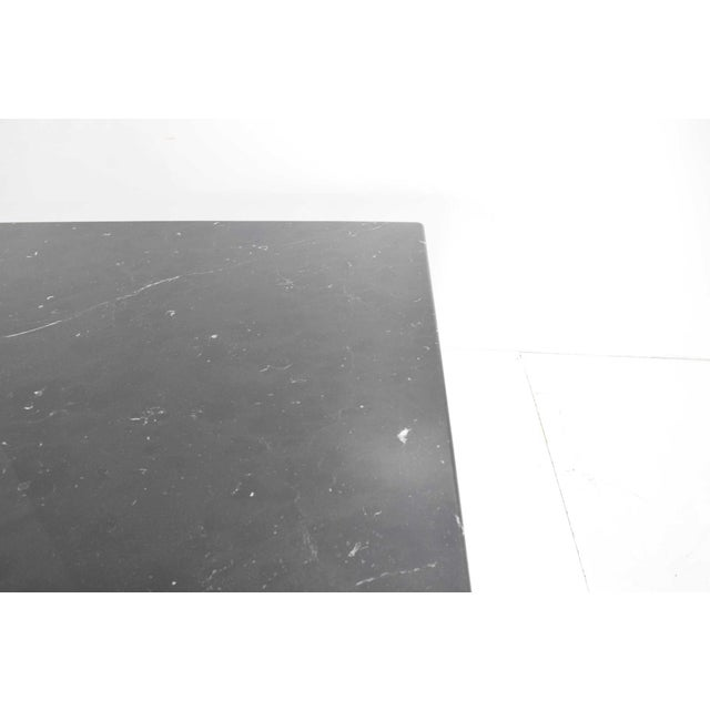 This monumental table by Milanese architect Mario Bellini is made purely from solid Nero Marquina marble. The square top...