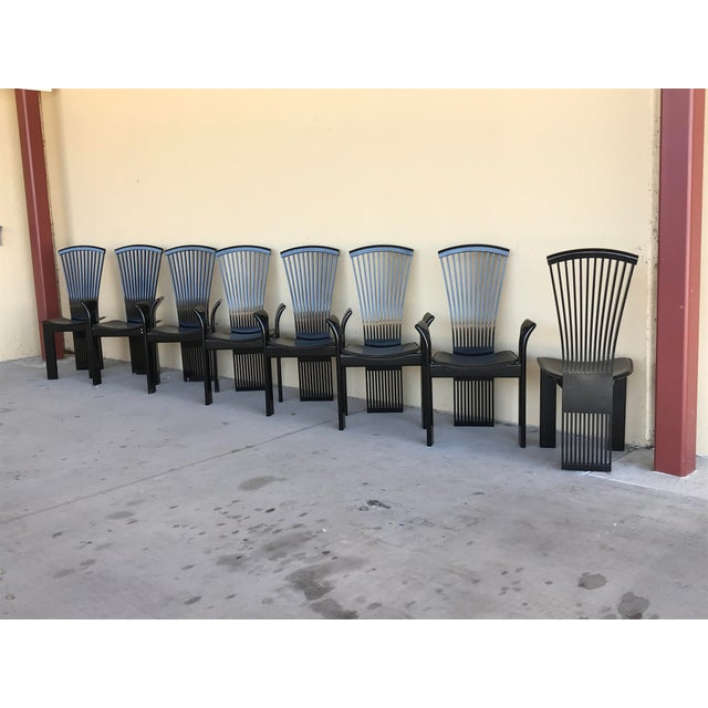 Set of 8 Italian rounded top rail, slatted high back black lacquered dining chairs (6 arm, 2 side) by Pietro Costantini....