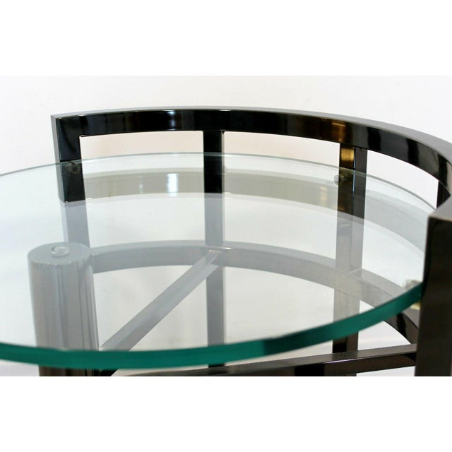 For your consideration is a lovely, asymmetrical, round side or end table, with a glass top on a gunmetal base, by...
