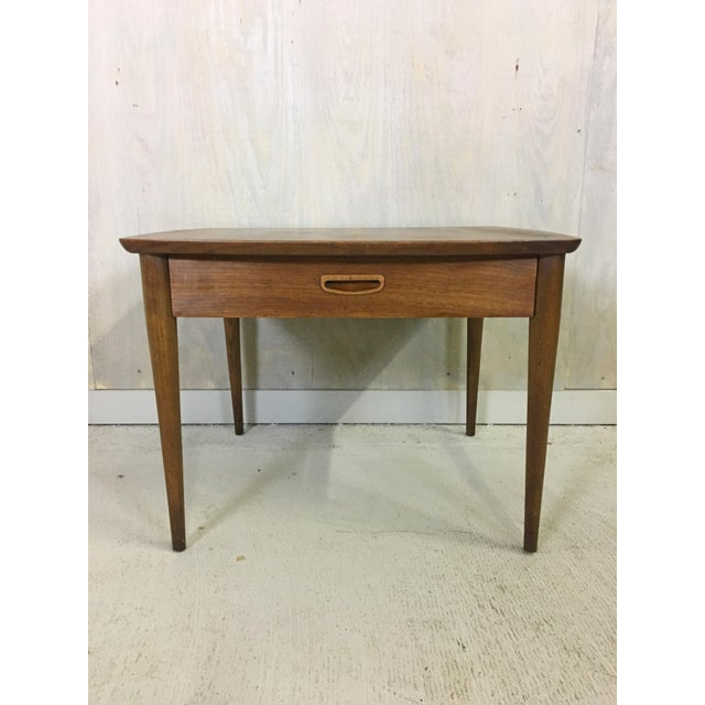 This elegant table manfactuered by Lane in the Danish modern style features a single drawer with an inset wood pull and...