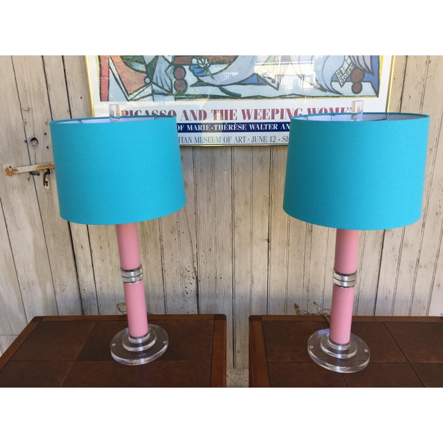 Gorgeous pink table lampswith lucite center and stunning turquoise shade. Adorable lucite block finials and bases....