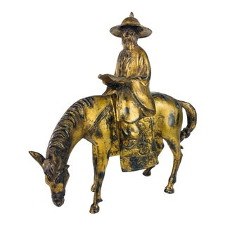 Vintage Asian Gilded Metal Sculpture of Man on a Horse For Sale