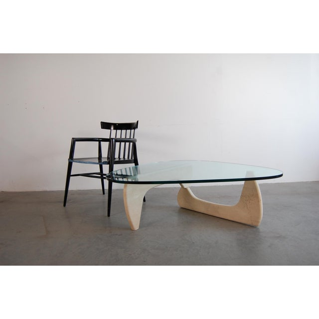 IN-50 Coffee Table, designed by Isamu Noguchi, circa 1948. This particular tables base is in Travertine marble, which is...
