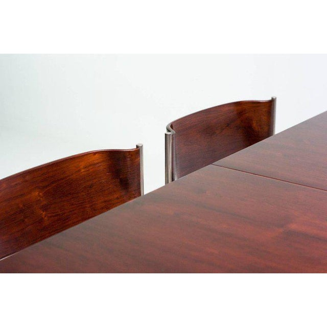Rare set of four rosewood dining chairs and matching extendable rosewood dining table. Chair frames and table legs in...