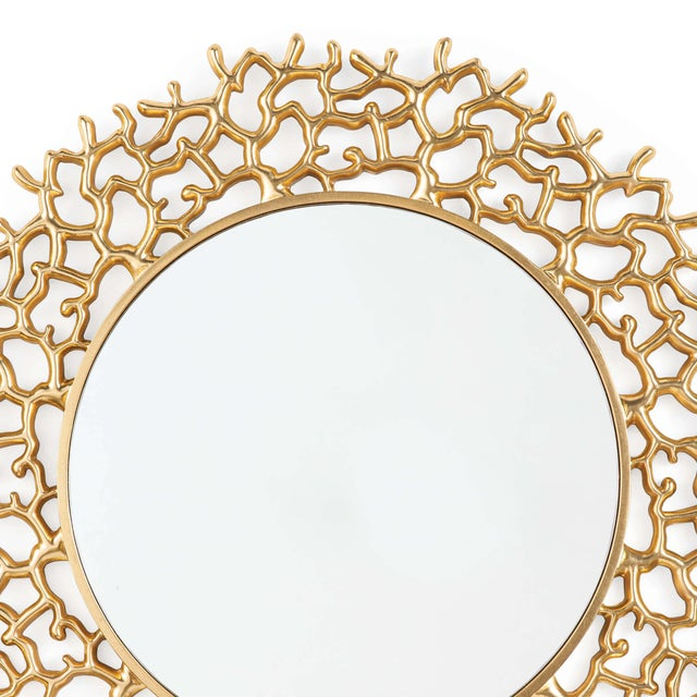 "Bold and modern, our Cora mirror measures 42"" in diameter. The organic coral motif has been gold gilded making this a..."