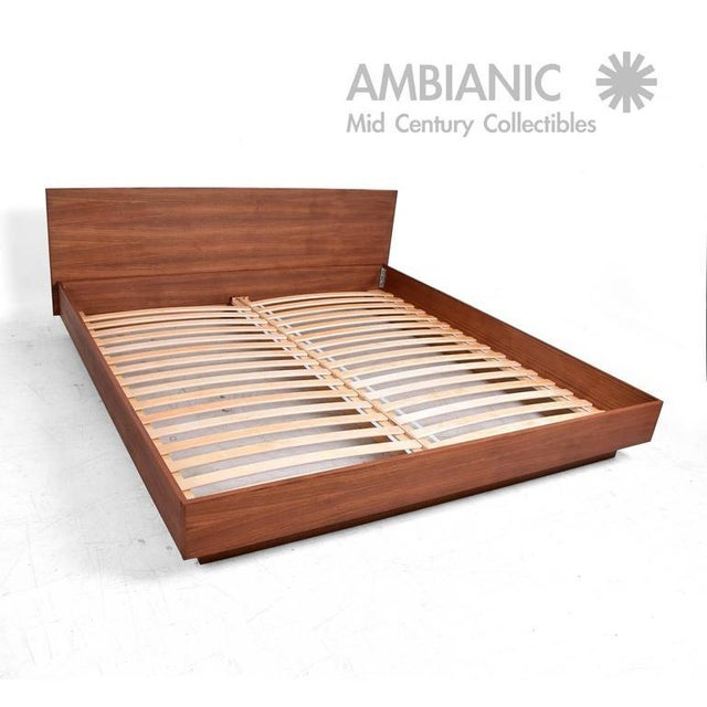 For your consideration a new teak King platform bed. Inspired in the Danish Modern, this is a new bed, never been used...