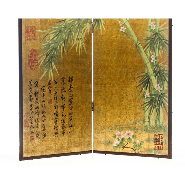 Showroom Sample. The magnificent hand-painted 2-panel screen shows a serene scene of four bamboo branches with a loving...
