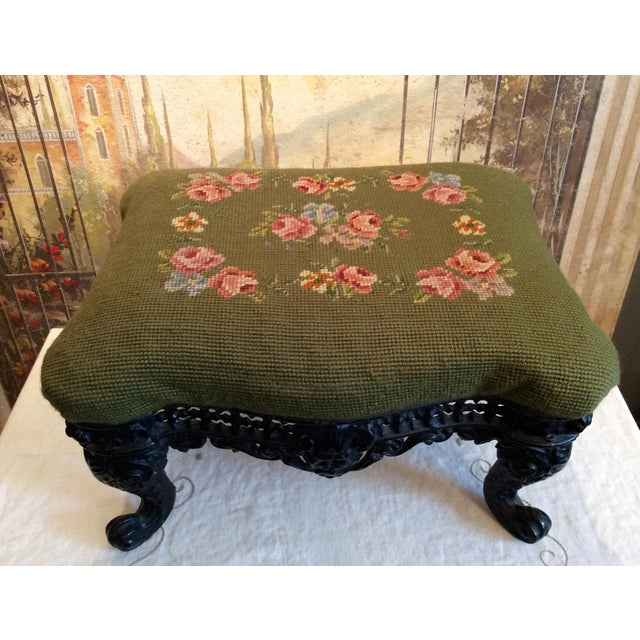 This charming Victorian Footstool is covered with traditional needlepoint featuring red roses, violets and foliage on a...