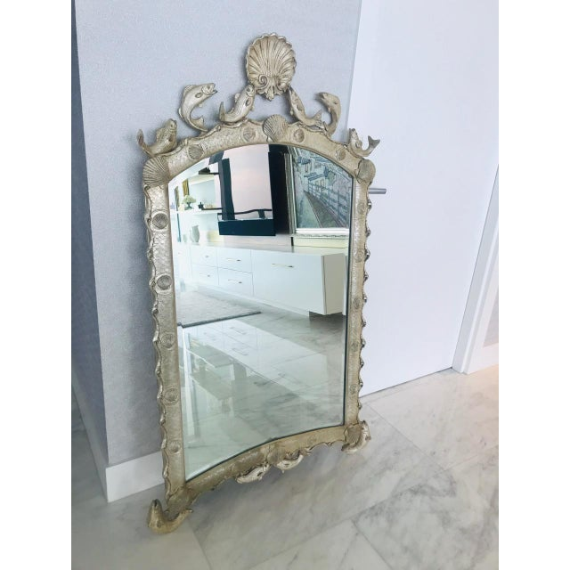 Stunning Venetian style scalloped mirror with ocean sea life theme. The mirror features an arched frame with scalloped...