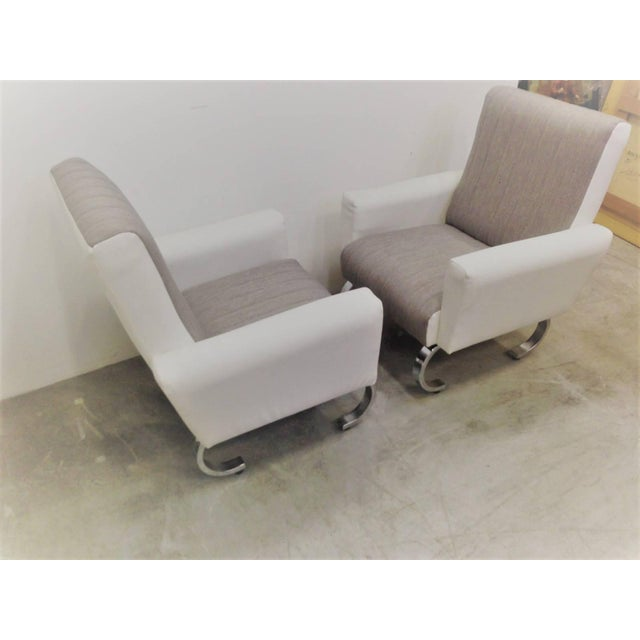 Mid-Century Modern exclusive pair of sleek Italian armchairs with metal base. Pair of wildly stylish Mid-Century tall back...