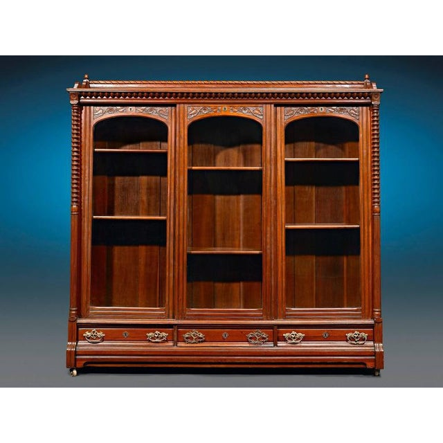Crafted of luxurious mahogany, this magnificent English bookcase captures the elegance of the Victorian period in grand...