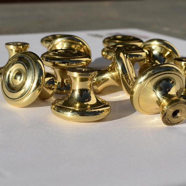 Vintage gold cabinet hardware knobs or drawer pulls in a beautiful gold. These round knobs are circular in shape, and flat...