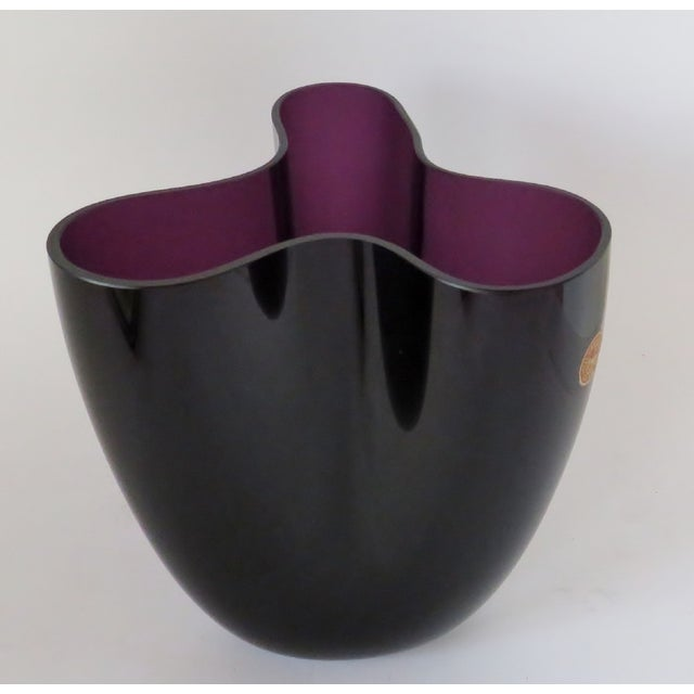 1955 Per Lütken for Holmegaard deep purple blown glass vase in a biomorphic shape. Original label, signed and dated by...