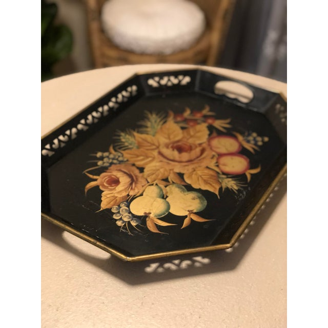 This is a gorgeous mid century error black hand painted floral motif on an extra large tray. Made in mid century era tin...