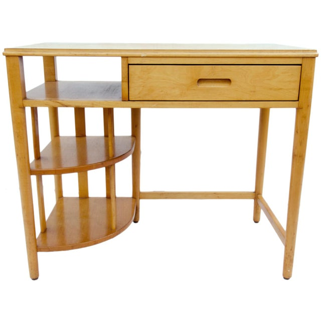 Mid-century modern Hill-Rom maple desk. Smaller in size, the surface measuring 36 by 20 and the height 30½. In good...