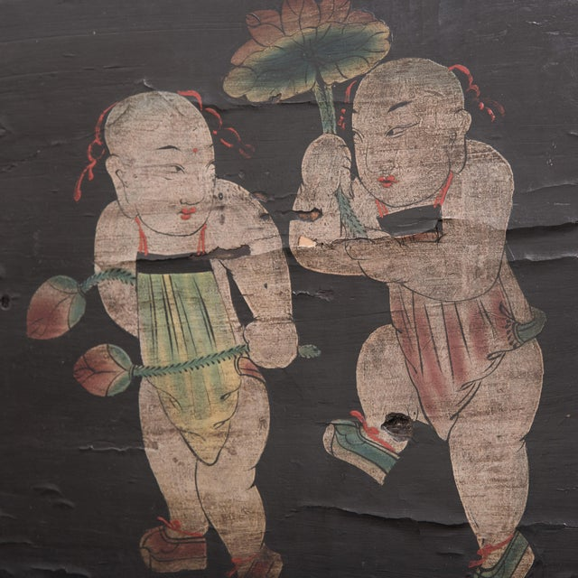 Created during the Qing dynasty, this hand-painted panel once concealed a compartment within a large cabinet. To the...
