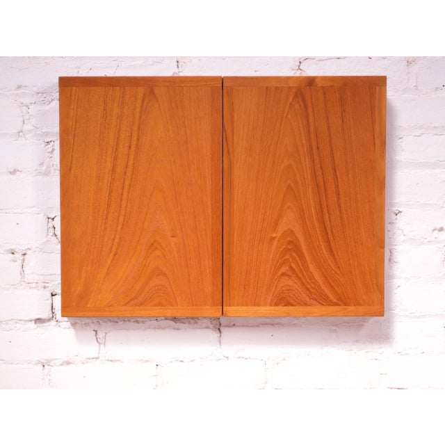 Folding triptych tabletop or wall-mounted mirror crafted in teak designed by Kai Kristiansen for Aksel Kjersgaard (circa...
