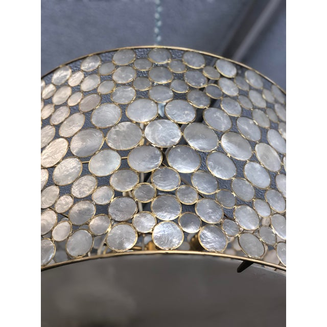 Handcrafted of naturally harvested seashells, this exclusive drum pendant lamp is fashioned from capiz discs framed with...