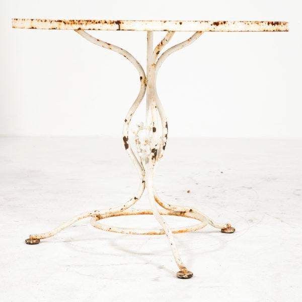 A vintage iron garden table with a lattice work top. Probably US. Could use a new coat of paint.