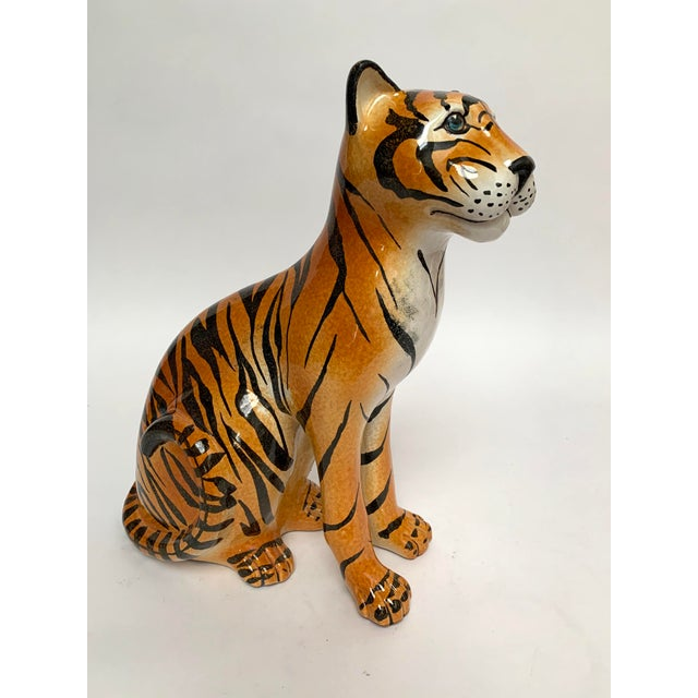 """Large and heavy terra cotta tiger sculpture ca. 1960s. The tiger is hand-painted and measures about 15"""" high x 12"""" deep x..."""