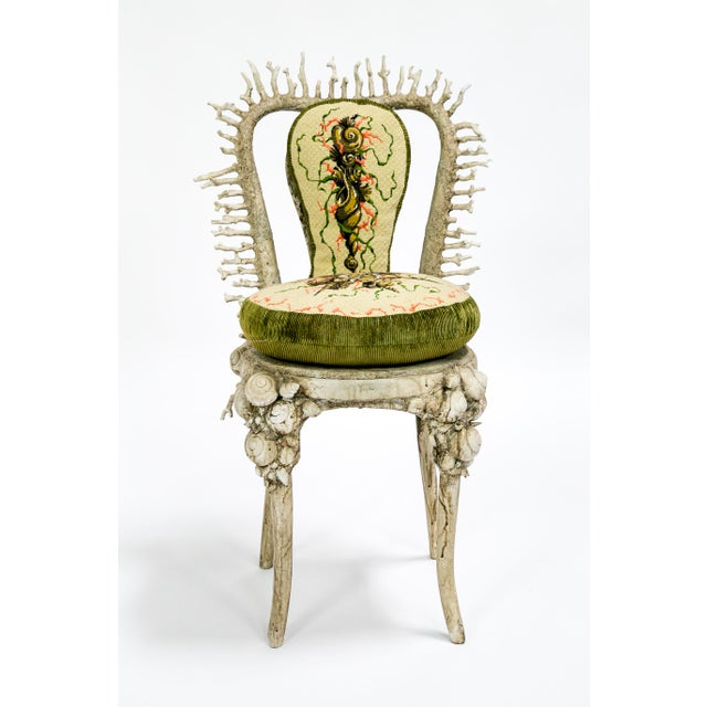 This extraordinary chair is encrusted with real shells and coral, and integrated with seamlessly with resin and paint. Its...