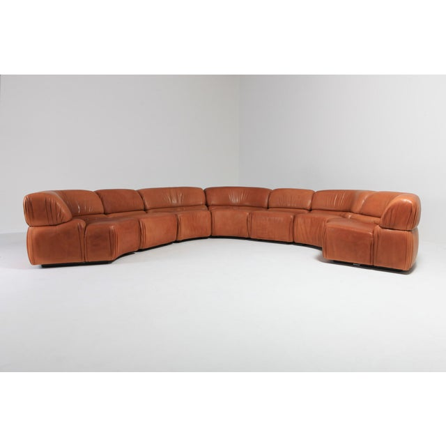 Modular De Sede 'Cosmos' sofa in original cognac leather. Iconic and stunning sectional sofa consisting of 7 pieces by...