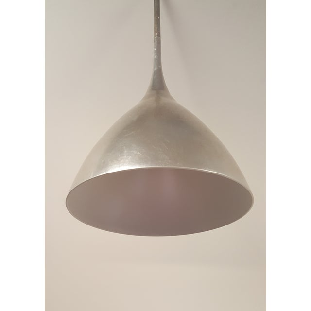 From the Aerin Collection, this is the Agnes small pendant light in burnished silver leaf with a white interior. Canopy:...