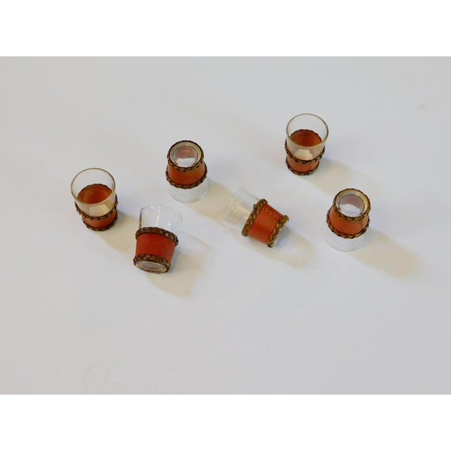 """1 5/8"""" diameter X 2 1/8"""" tall Circa: 1960's Condition: What a cool set of shot glasses! The woven leather covers are..."""