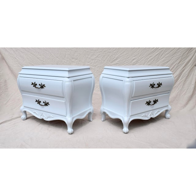 Pair of exquisite French-style bombé chests of two dovetailed drawers with original brass hardware. Newly lacquered in...