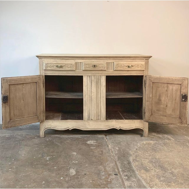 19th Century Rustic Regence Stripped Oak Buffet was sculpted from solid oak, and features the classic transitional motifs...