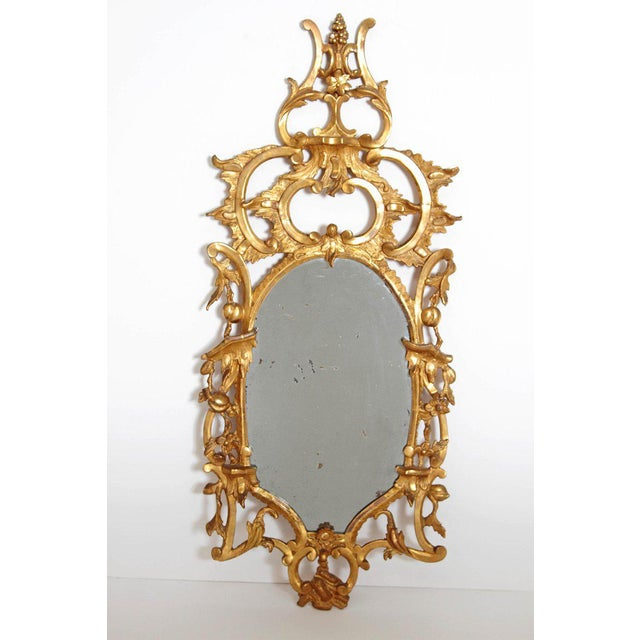 This elaborate 18th century English pier glass mirror is the ultimate statement piece. Masterfully carved with floral...